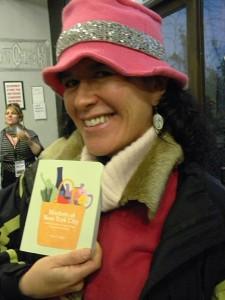 Markets of New York City Author Karen E. Seiger shows off her book and Schmutzerland Octopus Earrings