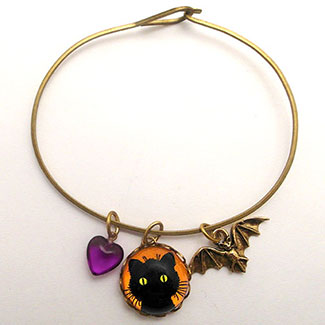 Green Eyed Cat with BAt Charm and Purple Heart Bead Bracelet